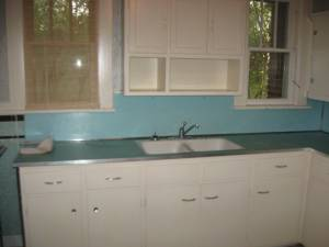 our funky blue kitchen, with laminate et al.  & one window shade!
